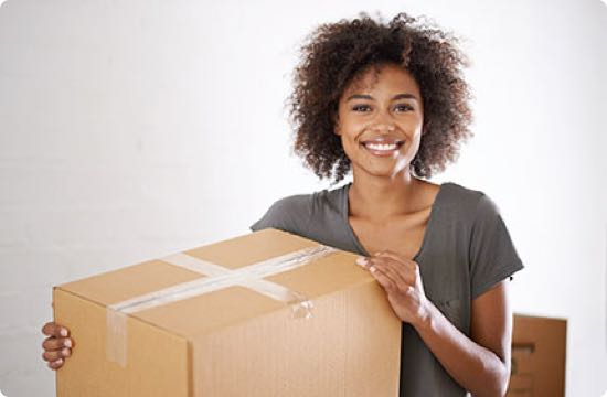Image: a woman with a box ready to move.