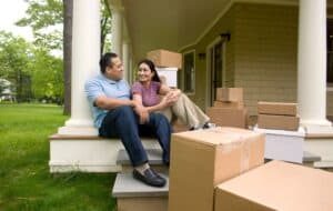 Image shows a family moving into a new home.