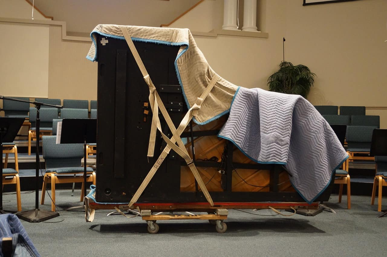 Image of a piano wrapped on a dolley for a large item move.
